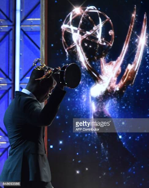Sterling K Brown accepts the award for Outstanding Lead Actor in a Drama Series for 'This is Us' onstage during the 69th Emmy Awards at the Microsoft...