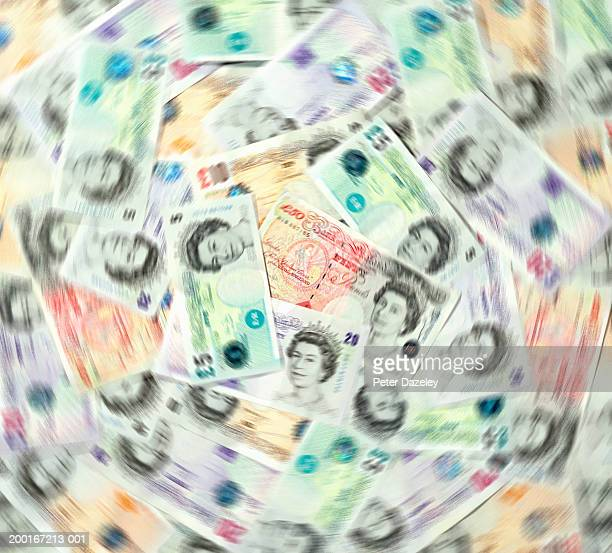 Sterling notes overlaid, spinning (blurred motion)