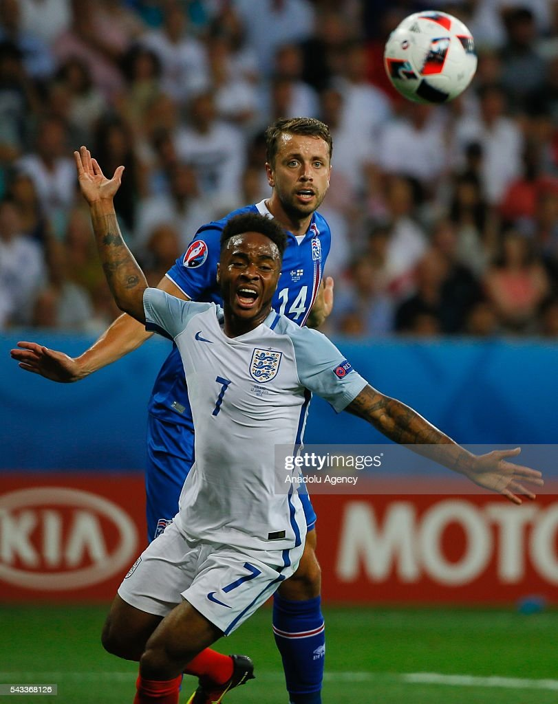 Sterling of England (L) vies with Arnason of Iceland (R) during the UEFA Euro 2016 Round of 16 football match between Iceland and England at Stade de Nice in Nice, France on June 27, 2016.