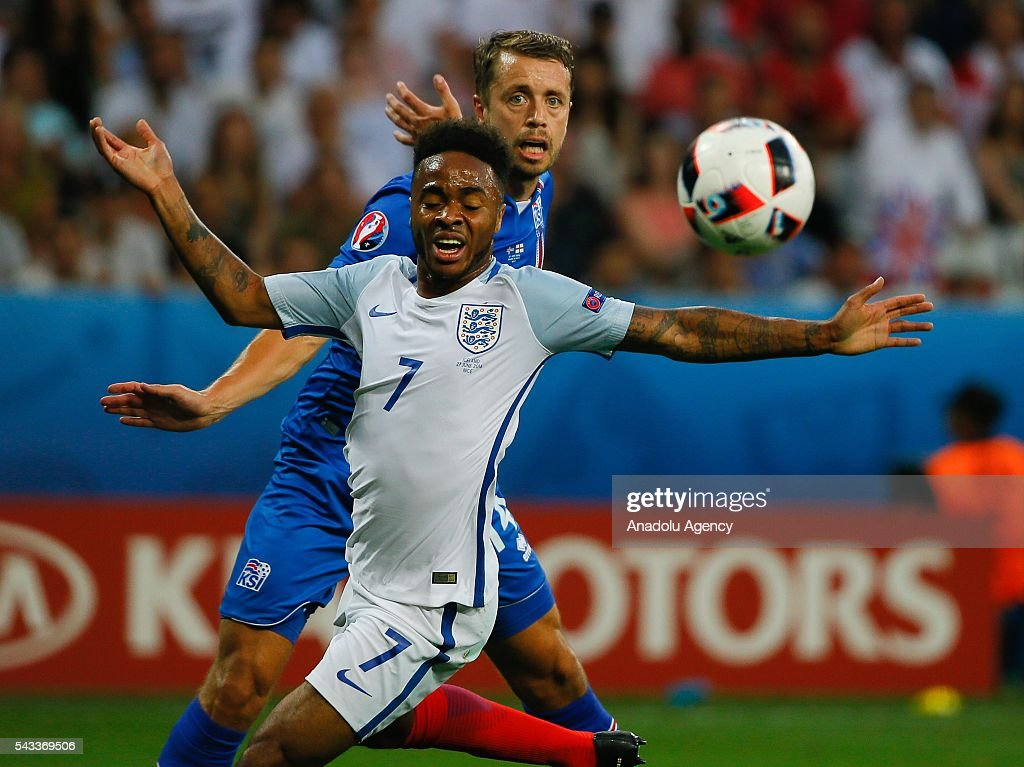 Sterling of England (front) vies with Arnason of Iceland (front) during the UEFA Euro 2016 Round of 16 football match between Iceland and England at Stade de Nice in Nice, France on June 27, 2016.