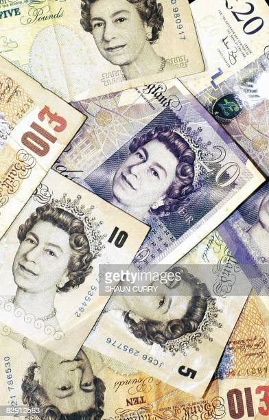 Sterling pound notes are pictured in London on December 4 2008The British pound hit a record euro low on Thursday while the single unit dipped...