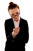 A businesswoman pointing at the viewer on a white background.