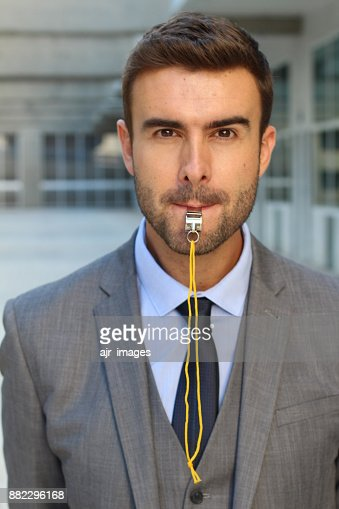 Stern man blowing the whistle in office space : Stock Photo