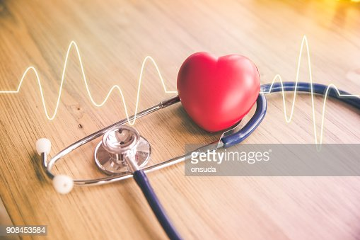 stethoscope and red heart with cardiogram : Stock Photo