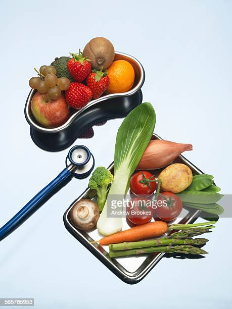 Stethoscope between trays of fresh fruits and vegetables