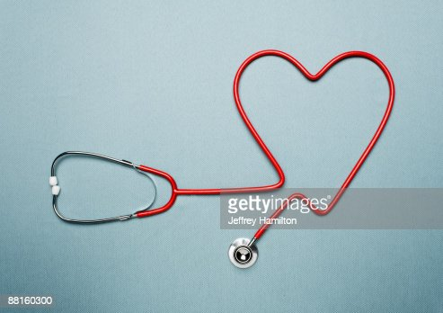 Stethoscope forming heart shape : Stock Photo