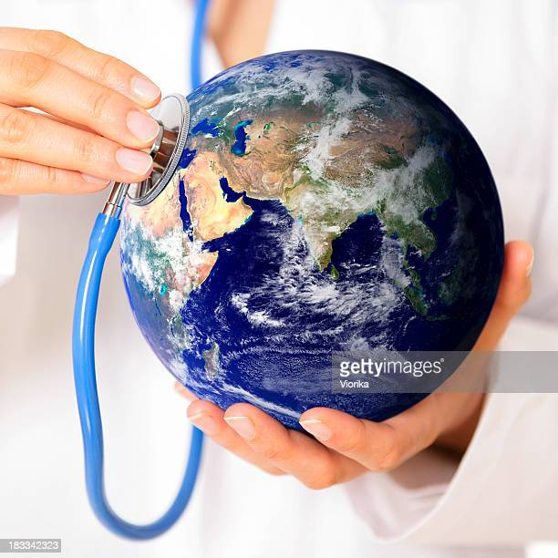 A stethoscope held to the world depicting global healthcare