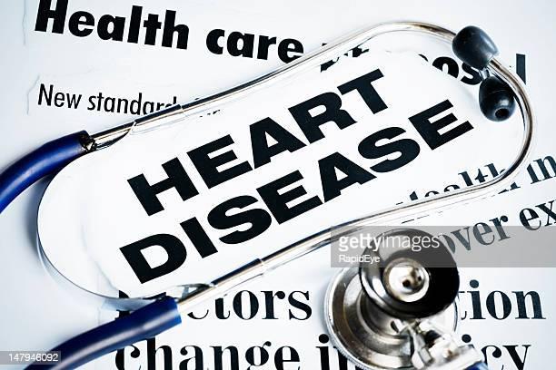 Stethoscope lying on Heart Disease headlines