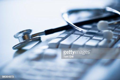Stethoscope on computer keyboard : Stock Photo