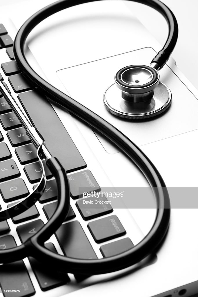 Stethoscope on laptop computer : Stock Photo
