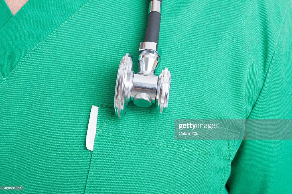 Stethoscope on medical uniform : Stock Photo