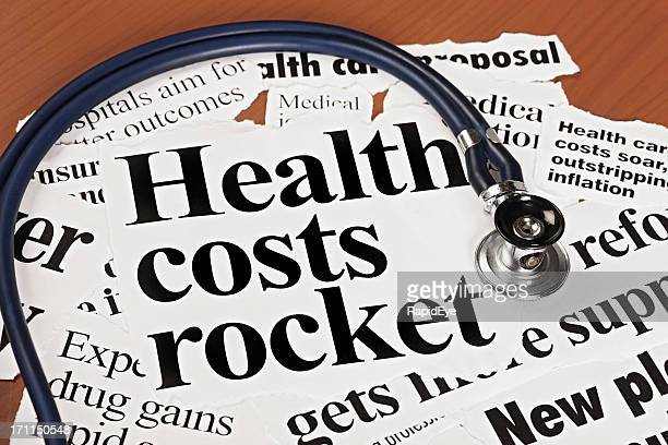 Stethoscope on newspaper headlines about health cost hikes