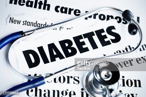 Stethoscope rests on headlines concerning diabetes