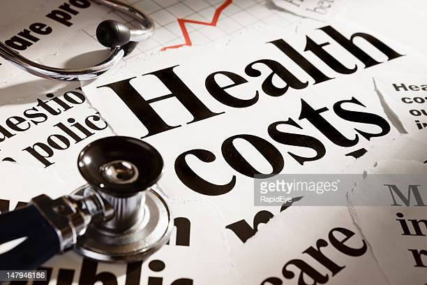 Stethoscope rests on headlines concerning health costs, plus rising graph