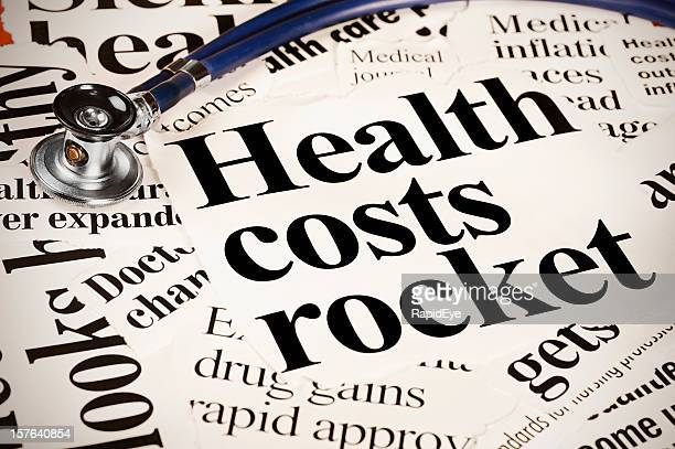 Stethoscope sits on newspaper headlines regarding health costs
