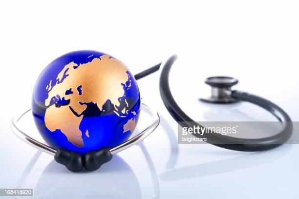 Stethoscope surrounding a golden globe