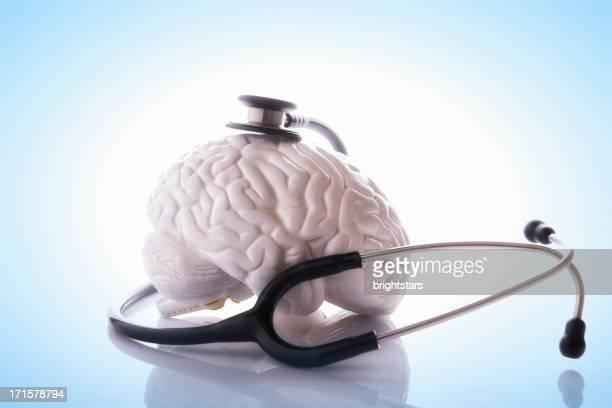 Stethoscope surrounding a model brain