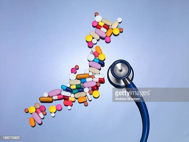 Stethoscope with pills in shape of Japan