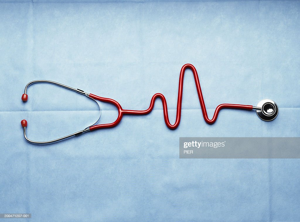 Stethoscope with pipe in shape of heartbeat, close-up : Stock Photo