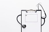 Stethoscope with prescription pad on clipboard with copy space.
