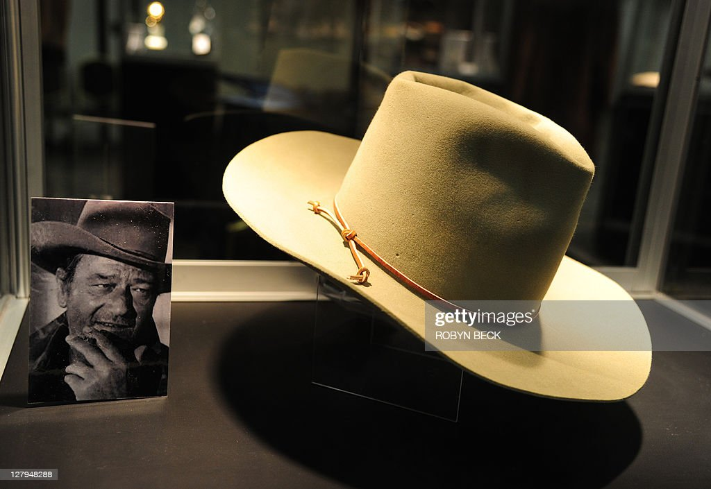 A Stetson cowboy hat worn by actor John Wayne in 'The Man Who Shot Liberty Valance' is on display at an auction preview of items owned by the iconic...