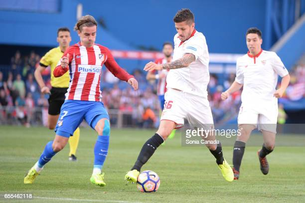 Stevan Jovetic #16 of Sevilla FC and Antoine Griezmann #7 of Atletico de Madrid during The La Liga match between Atletico Madrid v Valencia FC at...
