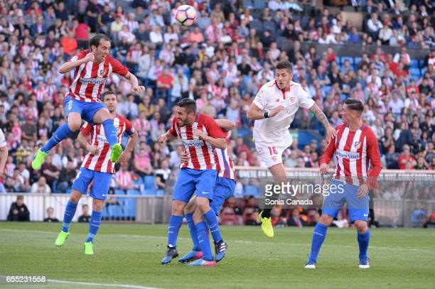 Stevan Jovetic #16 of Sevilla FC and Diego Godin #2 of Atletico de Madrid during The La Liga match between Atletico Madrid v Valencia FC at Vicente...