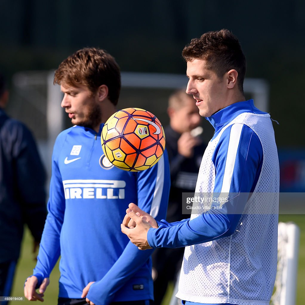 Stevan Jovetic (R) and Adem Ljajic chat during a FC Internazionale training session at the club's training ground at Appiano Gentile on October 23, 2015 in Como, Italy.