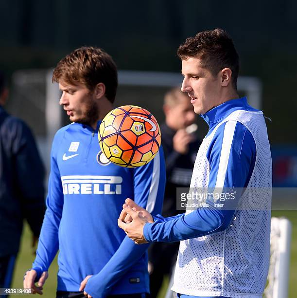 Stevan Jovetic and Adem Ljajic chat during a FC Internazionale training session at the club's training ground at Appiano Gentile on October 23 2015...