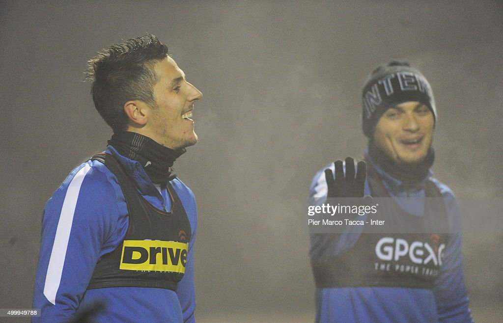 Stevan Jovetic and Adem Ljajic in action during the training session at Appiano Gentile on December 4, 2015 in Como, Italy.