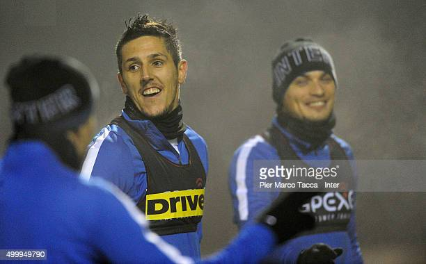 Stevan Jovetic and Adem Ljajic in action during the training session at Appiano Gentile on December 4 2015 in Como Italy