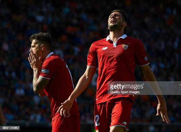 Stevan Jovetic and Franco Vazquez of Sevilla reacts during the La Liga match between Valencia CF and Sevilla FC at Mestalla Stadium on April 16 2017...