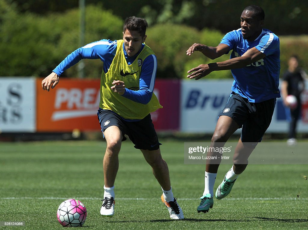 Stevan Jovetic is challenged by <a gi-track='captionPersonalityLinkClicked' href=/galleries/search?phrase=Geoffrey+Kondogbia&family=editorial&specificpeople=7552237 ng-click='$event.stopPropagation()'>Geoffrey Kondogbia</a> during the FC Internazionale training session at the club's training ground 'La Pinetina' on May 4, 2016 in Como, Italy.