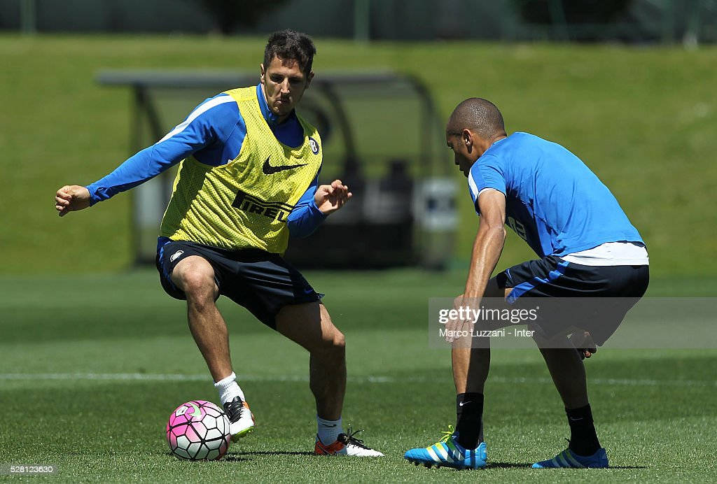Stevan Jovetic is challenged by Joao Miranda during the FC Internazionale training session at the club's training ground 'La Pinetina' on May 4, 2016 in Como, Italy.