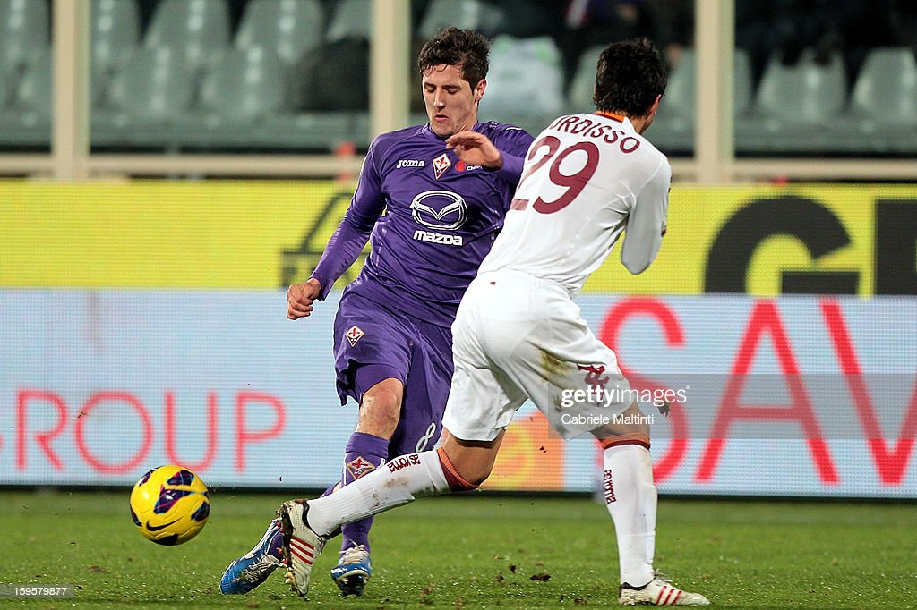 Stevan Jovetic of ACF Fiorentina fights for the ball with Nicolas Burdisso of AS Roma during the TIM cup match between ACF Fiorentina and AS Roma at Artemio Franchi on January 16, 2013 in Florence, Italy.