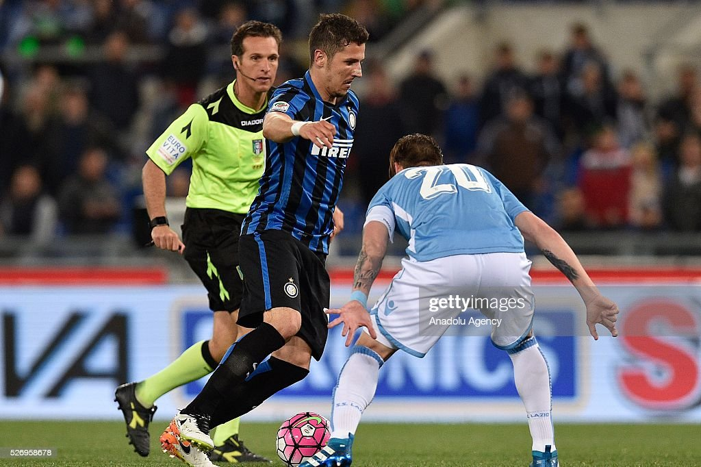 Stevan Jovetic (L) of FC Inter competes with Lucas Biglia (R) during the Serie A match between SS Lazio and FC Internazionale Milano at Stadio Olimpico on May 1, 2016 in Rome, Italy.