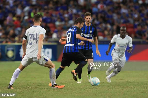 Stevan Jovetic of FC Internazionale and Gary Cahill of Chelsea FC competes for the ball during the International Champions Cup match between FC...