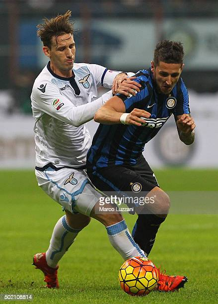 Stevan Jovetic of FC Internazionale Milano competes for the ball with Lucas Biglia of SS Lazio during the Serie A match between FC Internazionale...