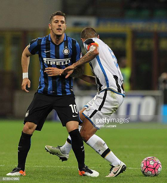 Stevan Jovetic of FC Internazionale Milano competes for the ball with Danilo Larangeira of Udinese Calcio during the Serie A match between FC...