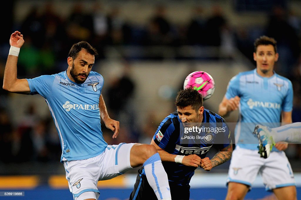 Stevan Jovetic (R) of FC Internazionale Milano competes for the ball with Santiago Gentiletti of SS Lazio during the Serie A match between SS Lazio and FC Internazionale Milano at Stadio Olimpico on May 1, 2016 in Rome, Italy.