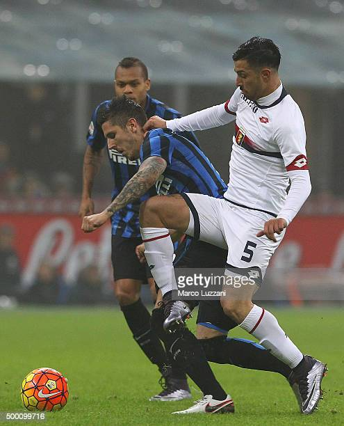 Stevan Jovetic of FC Internazionale Milano competes with Armando Izzo of Genoa CFC during the Serie A match between FC Internazionale Milano and...