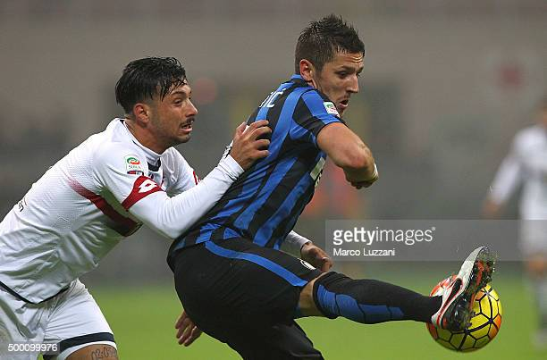 Stevan Jovetic of FC Internazionale Milano is challenged by Armando Izzo of Genoa CFC during the Serie A match between FC Internazionale Milano and...