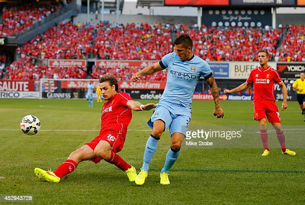 Stevan Jovetic of Manchester City and Sebastian Coates of Liverpool vie for the ball during the International Champions Cup 2014 at Yankee Stadium on...