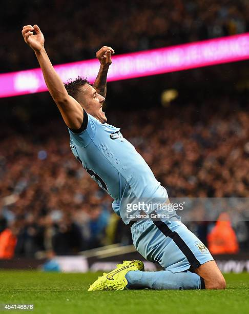 Stevan Jovetic of Manchester City celebrates scoring the opening goal during the Barclays Premier League match between Manchester City and Liverpool...