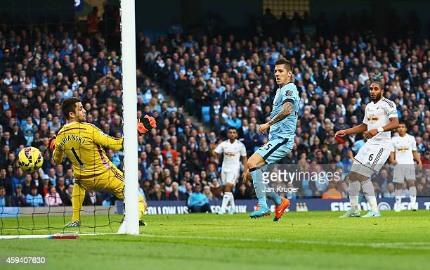 Stevan Jovetic of Manchester City scores his goal during the Barclays Premier League match between Manchester City and Swansea City at Etihad Stadium...