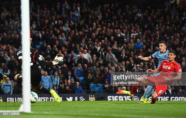 Stevan Jovetic of Manchester City scores the opening goal during the Barclays Premier League match between Manchester City and Liverpool at the...