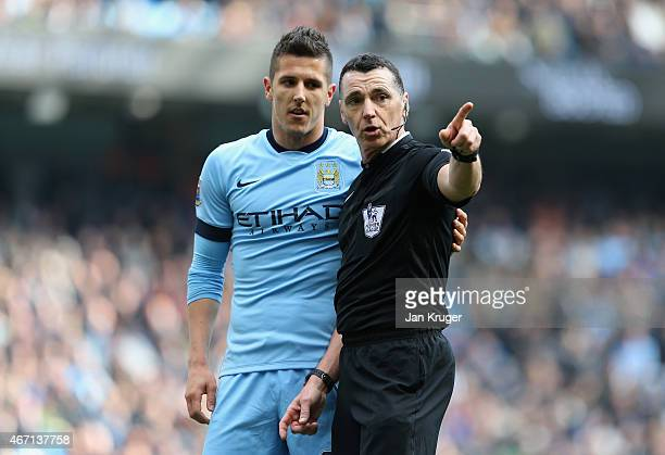Stevan Jovetic of Manchester City speaks to Referee Neil Swarbrick during the Barclays Premier League match between Manchester City and West Bromwich...