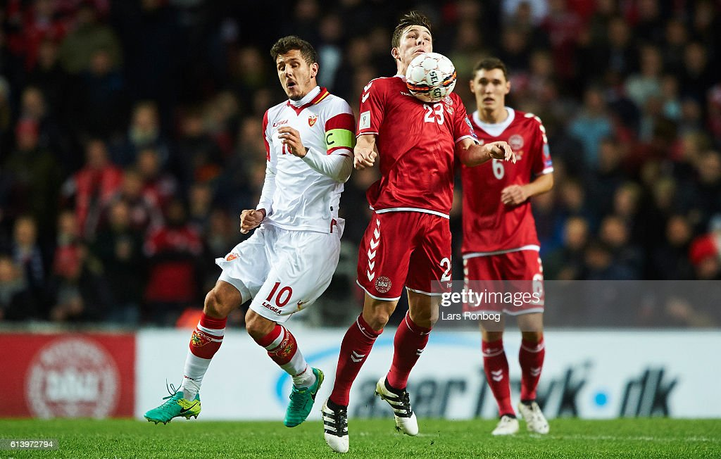 Stevan Jovetic of Montenegro and Pierre-Emile Hojbjerg of Denmark compete for the ball during the FIFA World Cup 2018 european qualifier match between Denmark and Montenegro at Telia Parken Stadium on October 11, 2016 in Copenhagen, Denmark.