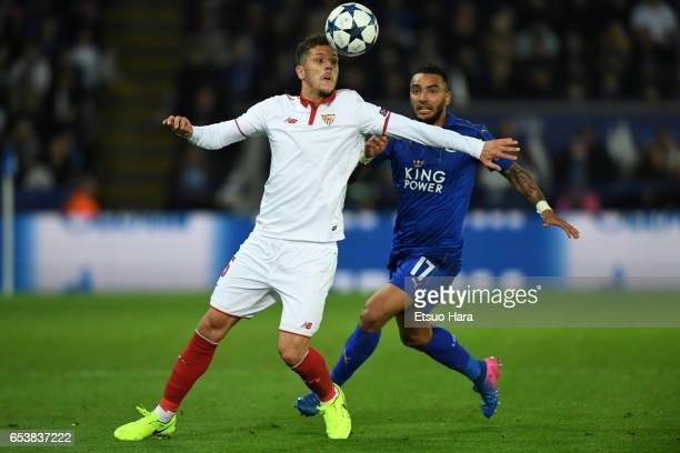 Stevan Jovetic of Sevilla and Danny Simpson of Leicester City compete for the ball during the UEFA Champions League Round of 16 second leg match...