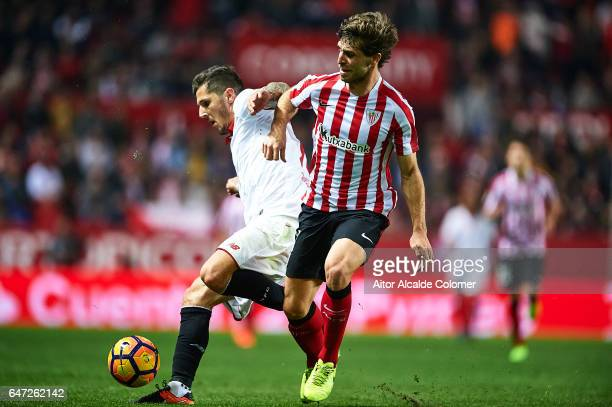 Stevan Jovetic of Sevilla FC competes for the ball with Yeray Alvarez of Athletic Club during the La Liga match between Sevilla FC and Athletic Club...